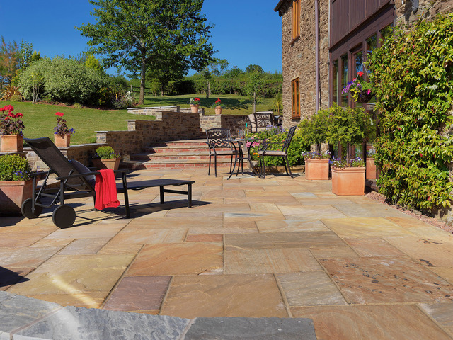 Natural stone patios shown off with a feature image
